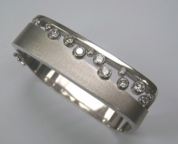 Brushed and Polished White Gold Bangle with Bezel Set Diamonds